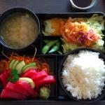 Tuna sashimi box with rice, miso soup, edamame, salad with a refreshing pineapple dressing