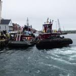 Tug boats tie up right outside the restaurant