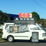 Van advertising their daily special pies.