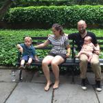 Family photo at a Conservancy Garden Bench.