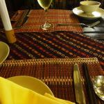 The dining tables with beautiful handcrafted table cloth/mats