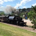 a steam engine occasionally puffs past the front porch