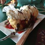A dessert to die for -- Belgian waffle, strawberries, ice cream, etc.