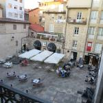 View from room of small plaza with cafes