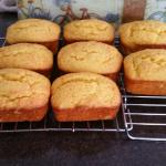 Individual orange cakes fresh from the oven.