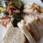 King prawn sandwich on fresh white bread with salad