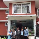 A family Photo with Mr Sharma (in Half Jersey ),Hotel Greenfields, Manali