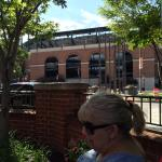 Sitting in the hotels outside patio area with the ballpark behind us.