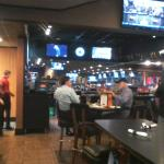 A view inside, looking toward the bar. Note all the television screens.