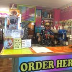 Owner behind the counter serving up treats