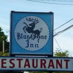 Roadside sign for BlueStone Inn Restaurant