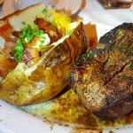 The Harvest Salad which is really awesome and a baked potato with a nice filet mignon steak.