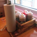 Sauces on the table with a roll of paper towels