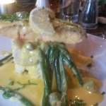 Salmon on bed of crushed new potatoes, green beans and hollandaise sauce