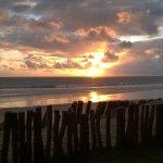Nascer do sol no pontal de Maracaípe visto do deck da pousada.