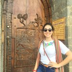 Beautiful carved wooden door at the official entrance to the Posada
