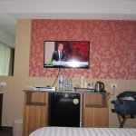 Watching TV on the bed with DVD fridge free water kettle etc