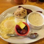 Eggs, grits, bacon, scone, fruit.