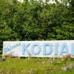 Welcome to Kodiak sign right beside the hotel