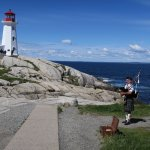 Peggy's Cove with a bagpipe player