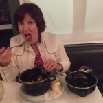 Enjoying the freshly cooked mussels
