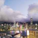 View from the rooftop terrace overlooking Victoria Harbour and the Hong Kong skyline