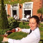 Sandra our Head Sommelier is busy busy in our garden serving the finest Rose wine