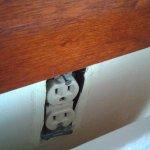 Electrical Outlet behind the bed