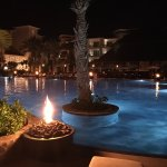 pool at night... fire everywhere... very romantic
