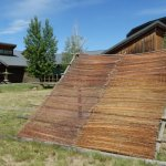 Drying rack and back of museum. Also several Tepees and small sweat lodge.