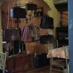 Wall divider made of antique leather luggages.