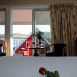 Deluxe Queen Room (1 Queen, 1 Double bed) with Veranda, Harbour view