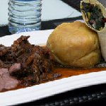 My meal : Matooke , some groundnut sauce, oxtail and veggies