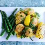 Sauted Scallops with asparagus , corn and saffron rice
