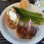 Bison Filet steak with baked potatoe and grilled asparagus