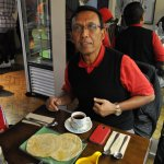 My dad having roti canai