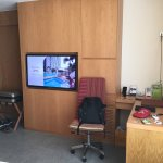 Office desk and huge TV with multiple TV channel