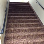 Large carpeted staircase, they do have elevators