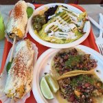Chicken quesadilla, shrimp tacos and corn on a stick