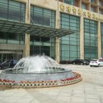 Fountain in front of hotel entrance.