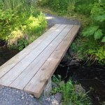 Wooden bridge across creek mentioned in review