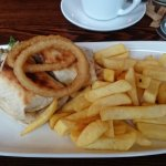 Burger in toasted tortilla, chunky chips, onion rings & BBQ sauce