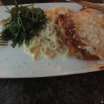 Chicken Parmesan with pasta alfredo and sauteed spinach.