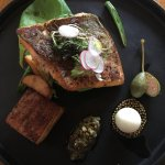 Arctic char with pork belly, potatoes, green beans and a quail egg.