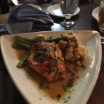 Baked, stuffed salmon with seafood