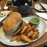 Steak, ale and mushroom pie with chips and mushy peas