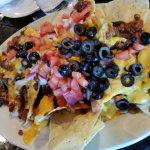 Too much chili and not enough chips for nachos,bacon was super greasy.