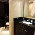 Bathroom with vanity, make-up area and wall to wall wardrobe.