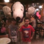 Our Kids with Snoopy inside Amber Waves Restaurant. After all, it's Snoopy's House.
