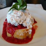 The whipped cream dessert with Strawberry Shortcake underneath.